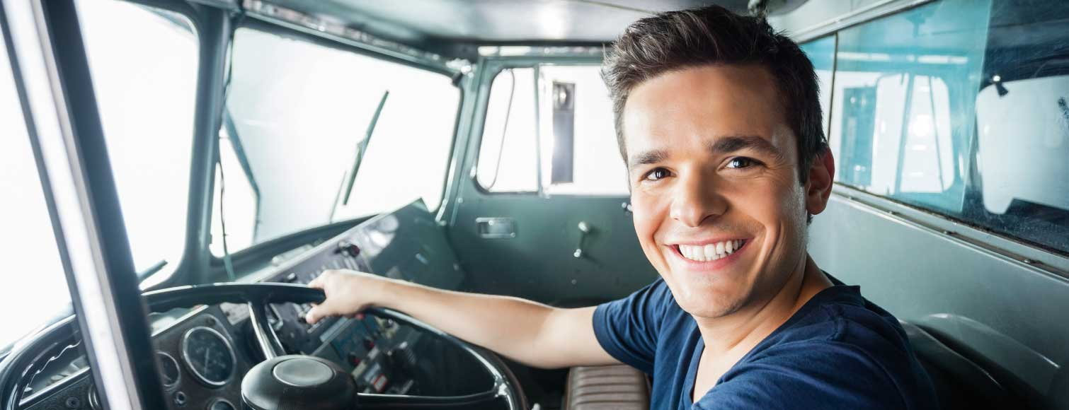Happy Young Man Driving Fire Truck